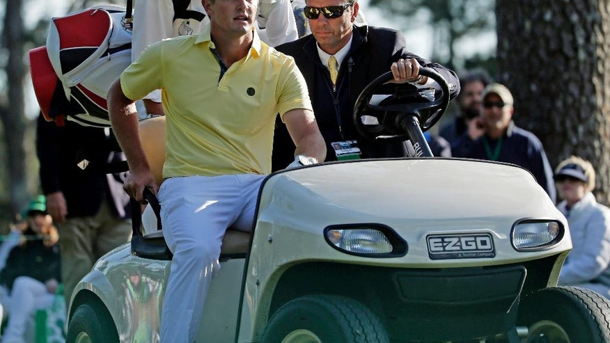 Amateur Bryson DeChambeau gets a cart ride after his second tee shot which landed out of bounds during the second round of the Masters golf tournament Friday, April 8, 2016, in Augusta, Ga. (AP Photo/Charlie Riedel)