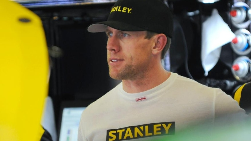 Carl Edwards stands in a garage during practice for the NASCAR Sprint Cup Series auto race at Texas Motor Speedway in Fort Worth, Texas, Thursday, April 7, 2016. (AP Photo/Ralph Lauer)
