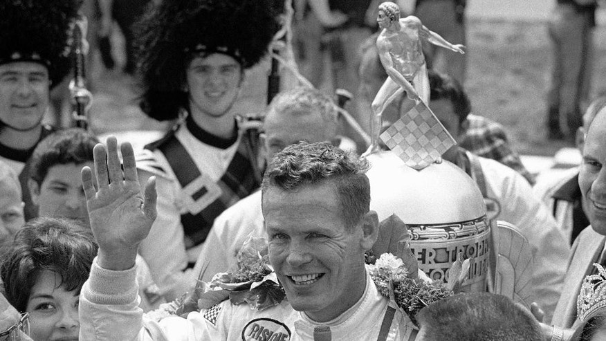 FILE - In this May 30, 1968, file photo, Bobby Unser  celebrates winning the 52nd running of the Indianapolis 500 auto race at Indianapolis Motor Speedway in Indianapolis, Ind. (AP Photo/File)