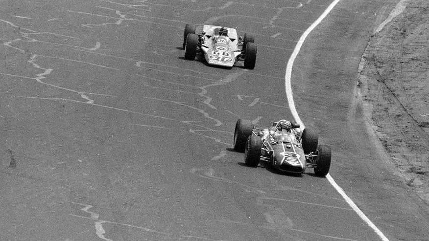 FILE - In this May 30, 1968, file photo, Bobby Unser (3) leads Joe Leonard (60) during the 52nd running of the Indianapolis 500 auto race at Indianapolis Motor Speedway in Indianapolis, Ind.  (AP Photo/File)