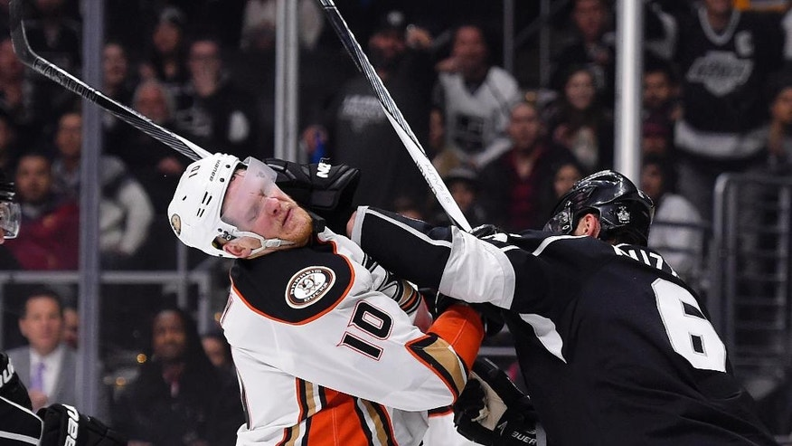 Anaheim Ducks right wing Corey Perry, left, and Los Angeles Kings defenseman Jake Muzzin scuffle during the first period of an NHL hockey game Thursday, April 7, 2016, in Los Angeles. (AP Photo/Mark J. Terrill)