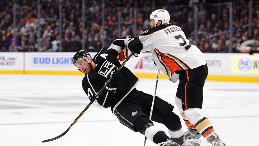 Anaheim Ducks defenseman Clayton Stoner, right, pushes over Los Angeles Kings center Jeff Carter during the second period of an NHL hockey game Thursday, April 7, 2016, in Los Angeles. (AP Photo/Mark J. Terrill)