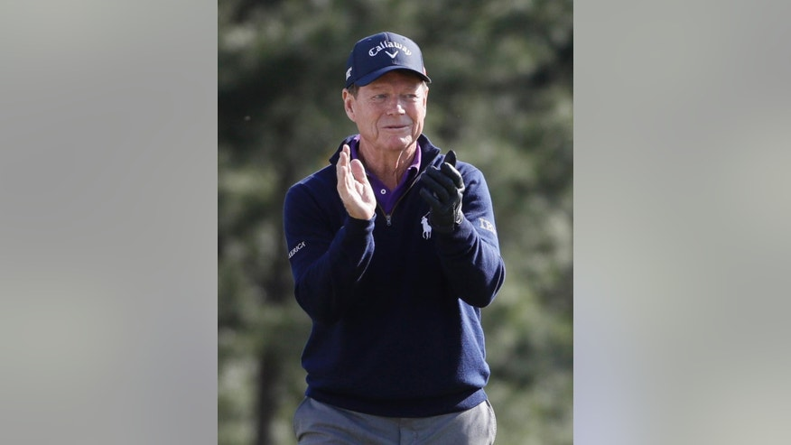 Tom Watson applauds the gallery on the 18th hole while playing his last round at the Masters golf tournament Friday, April 8, 2016, in Augusta, Ga. (AP Photo/Chris Carlson)