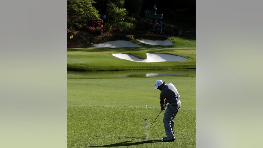 Phil Mickelson tees off on the 12th hole during the second round of the Masters golf tournament Friday, April 8, 2016, in Augusta, Ga. (AP Photo/Charlie Riedel)