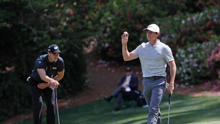 Rory McIlroy, of Northern Ireland, holds up his ball after a birdie on the 13th hole during the second round of the Masters golf tournament Friday, April 8, 2016, in Augusta, Ga. (AP Photo/David J. Phillip)