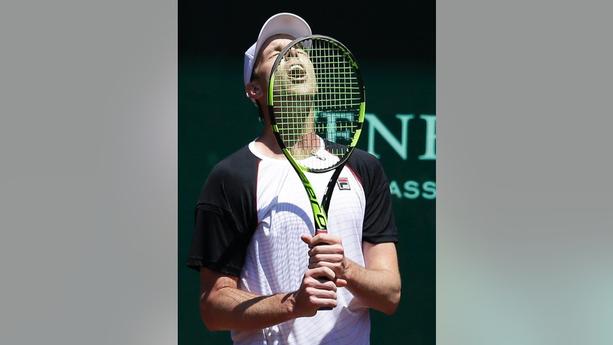 Sam Querrey of the United States screams after missing a chance to break the serve of Juan Monaco of Argentina in the quarterfinals of the U.S. men's clay court championships tennis tournament Friday, April 8, 2016, in Houston. Monaco won 6-4, 6-4. (AP Photo/Pat Sullivan)
