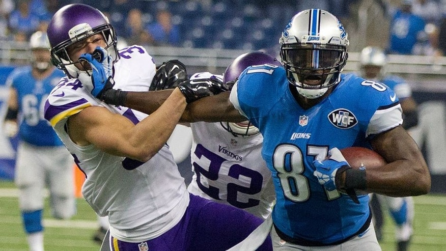 DETROIT, MI - OCTOBER 25: Calvin Johnson #81 of the Detroit Lions tries to avoid the tackle by Andrew Sendejo #34 of the Minnesota Vikings in the first half during an NFL game at Ford Field on October 25, 2015 in Detroit, Michigan. (Photo by Dave Reginek/Getty Images)