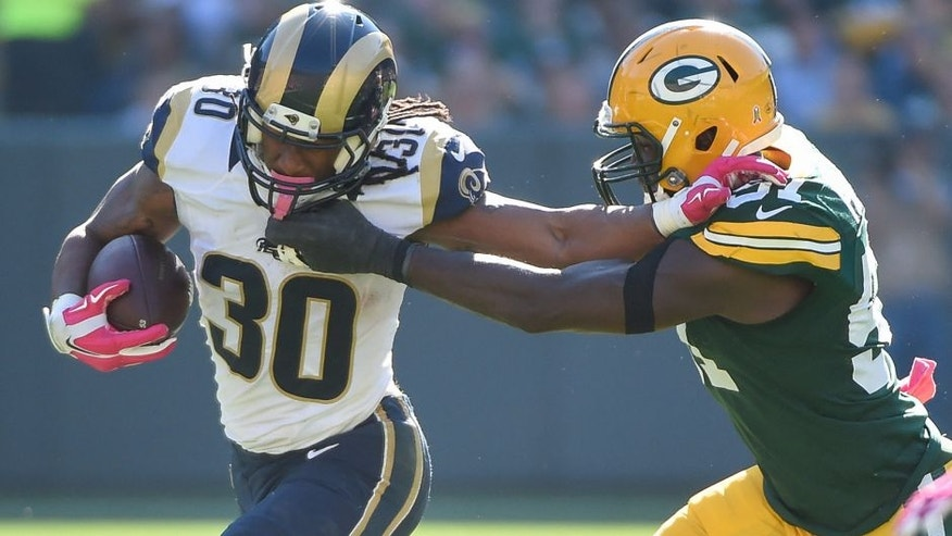 Oct 11, 2015; Green Bay, WI, USA; St. Louis Rams running back Todd Gurley (30) pushes away Green Bay Packers linebacker Nate Palmer (51) in the third quarter at Lambeau Field. Mandatory Credit: Benny Sieu-USA TODAY Sports