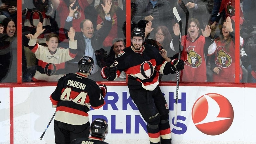 Ottawa Senators center Mika Zibanejad (93) celebrates a first period goal against the Florida Panthers with teammates Jean-Gabriel Pageau (44) and Nick Paul (13) during the first period of an NHL hockey game, Thursday, April 7, 2016 in Ottawa, Ontario. (Sean Kilpatrick/The Canadian Press via AP) MANDATORY CREDIT