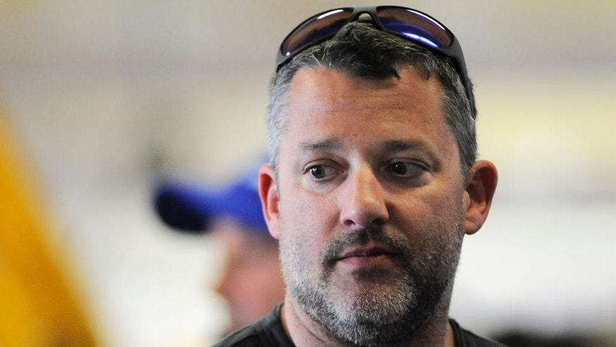 Tony Stewart hangs out in the garage during practice for Saturday's NASCAR Sprint Cup Series auto race at Texas Motor Speedway in Fort Worth, Texas, Thursday, April 7, 2016. (AP Photo/Ralph Lauer)