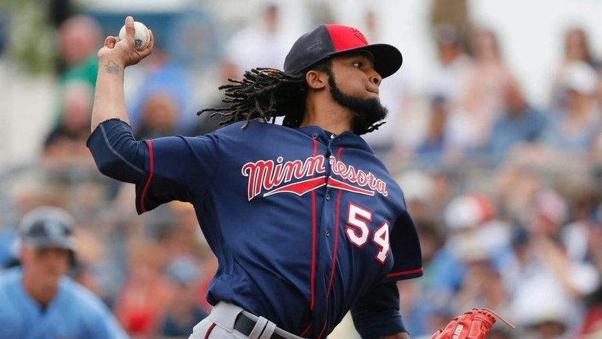 Minnesota Twins starting pitcher Ervin Santana works against the Tampa Bay Rays in the first inning of a spring training baseball game, Friday, March 25, 2016, in Port Charlotte, Fla. (AP Photo/Tony Gutierrez)