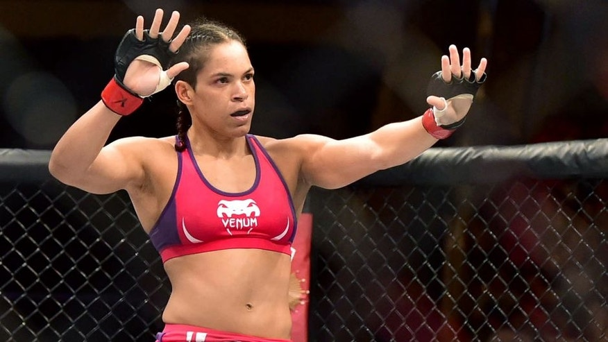 Mar 21, 2015; Rio de Janeiro, RJ, BRAZIL; Amanda Nunes (red gloves) reacts after defeating Shayna Baszler (blue gloves) during UFC Fight Night at Ginasio do Maracanazinho. Mandatory Credit: Jason Silva-USA TODAY Sports