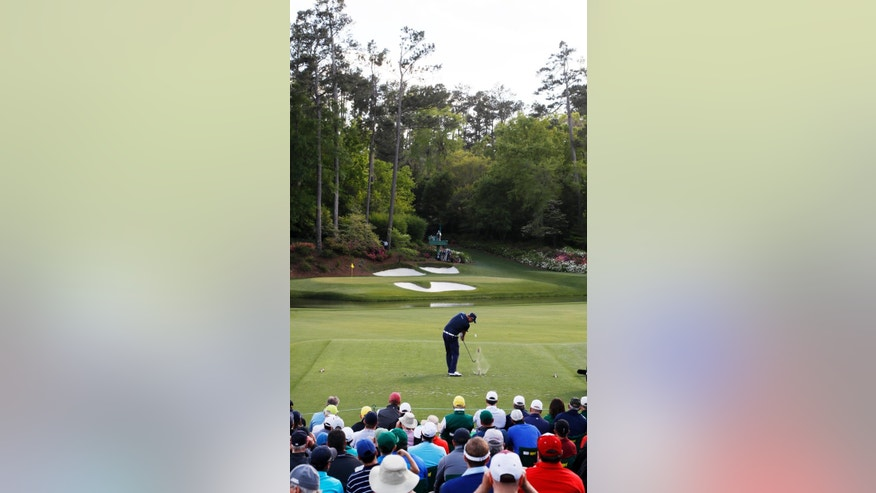 Marc Leishman, of Australia, tees off on the 12th hole during the second round of the Masters golf tournament Friday, April 8, 2016, in Augusta, Ga. (AP Photo/Charlie Riedel)