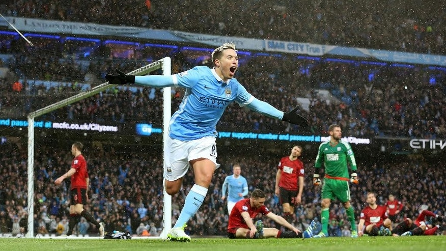 Manchester City's Samir Nasri celebrates scoring against West Bromwich Albion during the English Premier League soccer match at the Etihad Stadium, Manchester, England, Saturday April 9, 2016. (Martin Rickett/PA via AP) UNITED KINGDOM OUT