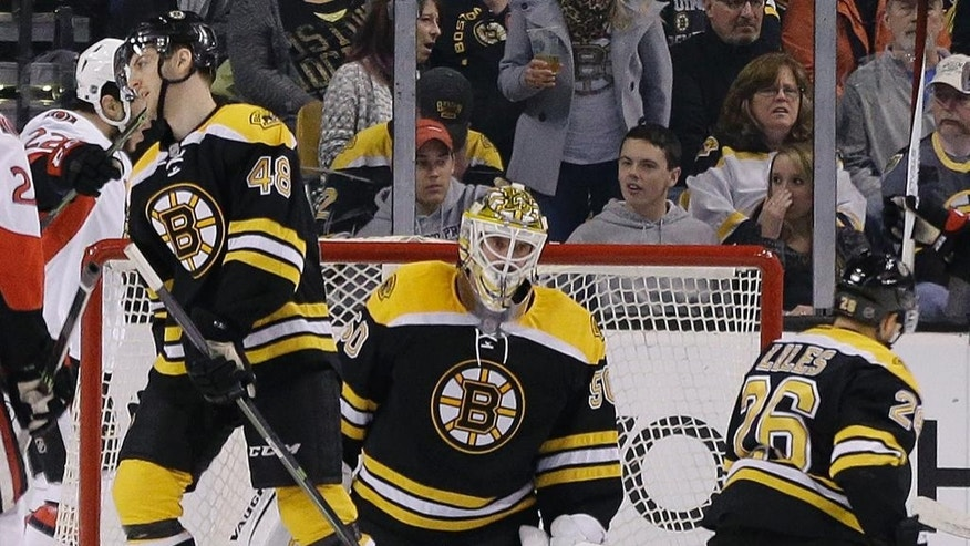 Boston Bruins goalie Jonas Gustavsson (50) reacts along with teammates defensemen Colin Miller (48) and John-Michael Liles (26) after the Ottawa Senators scored in the second period of an NHL hockey game, Saturday, April 9, 2016, in Boston. (AP Photo/Elise Amendola)