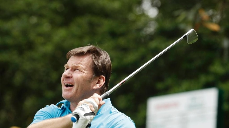 Nick Faldo watches his tee shot on the sixth hole during the par three competition at the Masters golf tournament Wednesday, April 6, 2016, in Augusta, Ga. (AP Photo/Charlie Riedel)