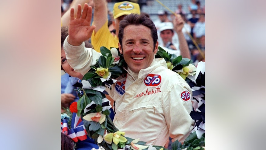 FILE - In this May 30, 1969, file photo, race car driver Mario Andretti waves from the winner's circle after winning the 53rd running of the Indianapolis 500 auto race at  Indianapolis Motor Speedway in Indianapolis, Ind.  (AP Photo/ File)
