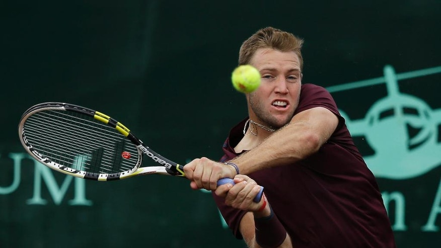 Jack Sock, of the United States, returns a shot against fellow American John Isner in the semifinals of the U.S. Men's Clay Court Championship tennis tournament Saturday, April 9, 2016, in Houston. Sock won 7-6 (4), 6-3. (AP Photo/Pat Sullivan)