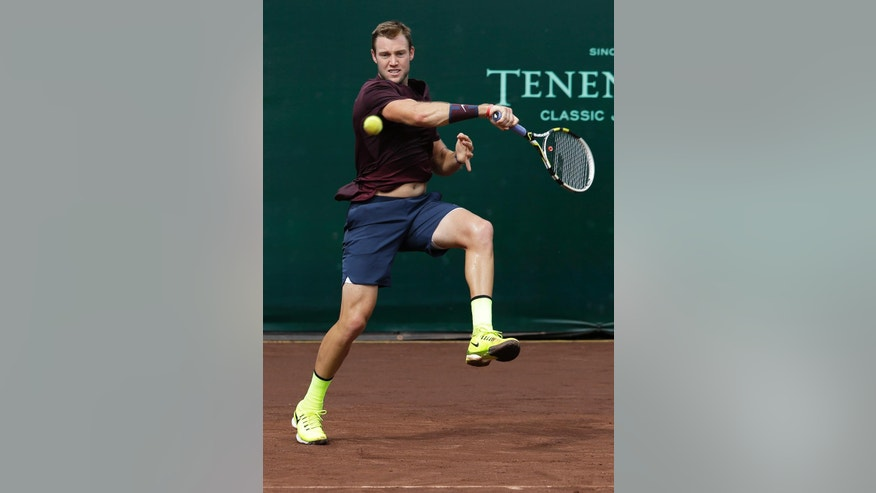 Jack Sock of the United States returns a shot against fellow American John Isner in the semifinals of the U.S. Men's Clay Court Championship tennis tournament Saturday, April 9, 2016, in Houston. (AP Photo/Pat Sullivan)