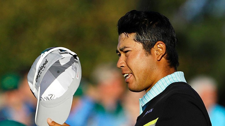 Hideki Matsuyama, of Japan, tips his cap after putting out on the 18th green during the third round of the Masters golf tournament Saturday, April 9, 2016, in Augusta, Ga. (AP Photo/David J. Phillip)