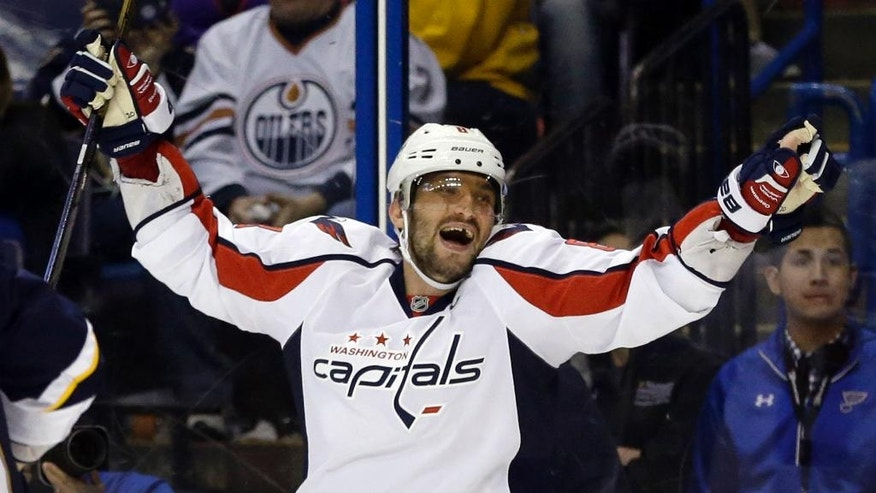 Washington Capitals' Alex Ovechkin, of Russia, celebrates after scoring his third goal of an NHL hockey game during the third period against the St. Louis Blues, Saturday, April 9, 2016, in St. Louis. (AP Photo/Jeff Roberson)