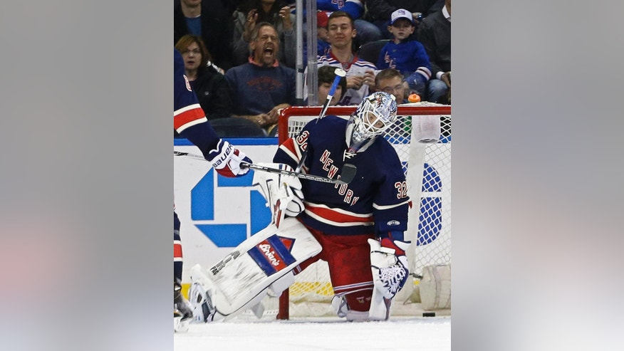 New York Rangers goalie Antti Raanta (32) reacts after Detroit Red Wings' Riley Sheahan scored a goal during the second period of an NHL hockey game Saturday, April 9, 2016, in New York. (AP Photo/Frank Franklin II)