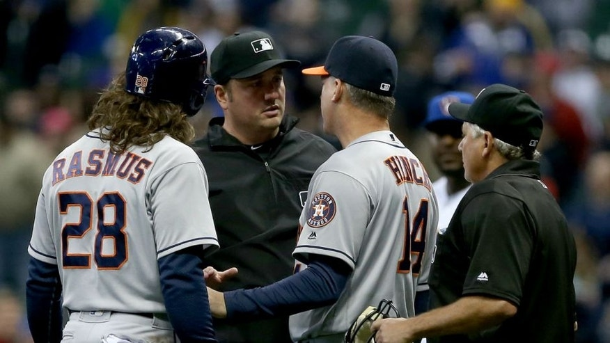 <p>MILWAUKEE, WI - APRIL 8: Manager A.J. Hinch and Colby Rasmus #28 of the Houston Astros argue a call by umpire Mike DiMuro, center, that ended the game against the Milwaukee Brewers at Miller Park April 8, 2016 in Milwaukee, Wisconsin. (Photo by Dylan Buell/Getty Images) *** Local Caption *** A.J. Hinch;Mike DiMuro,MILWAUKEE, WI - APRIL 8: Manager A.J. Hinch and Colby Rasmus #28 of the Houston Astros argue a call by umpire Mike DiMuro, center, that ended the game against the Milwaukee Brewers at Miller Park April 8, 2016 in Milwaukee, Wisconsin. (Photo by Dylan Buell/Getty Images)</p>