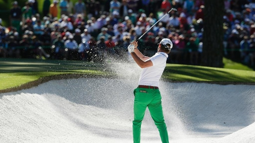 Smylie Kaufman chips out of a bunker on the 15th hole during the third round of the Masters golf tournament Saturday, April 9, 2016, in Augusta, Ga. (AP Photo/Charlie Riedel)