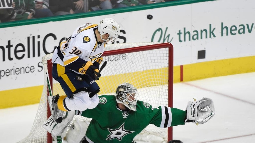 Nashville Predators right wing Viktor Arvidsson (38) jumps in front of Dallas Stars goalie Antti Niemi (31) during a shot in the second period of an NHL hockey game Saturday, April 9, 2016, in Dallas. (AP Photo/Michael Ainsworth)