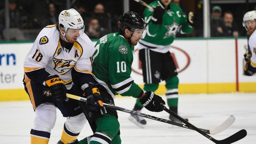 Nashville Predators left wing James Neal (18) and Dallas Stars left wing Patrick Sharp (10) chase the puck during the first period of an NHL hockey game on Saturday, April 9, 2016, in Dallas. (AP Photo/Michael Ainsworth)
