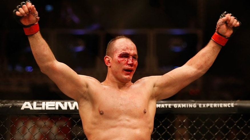 PHOENIX, AZ - DECEMBER 13: Junior dos Santos celebrates after defeating Stipe Miocic (not pictured) by unanimous decision in their heavyweight bout during the UFC Fight Night event at the at U.S. Airways Center on December 13, 2014 in Phoenix, Arizona. (Photo by Christian Petersen/Getty Images)