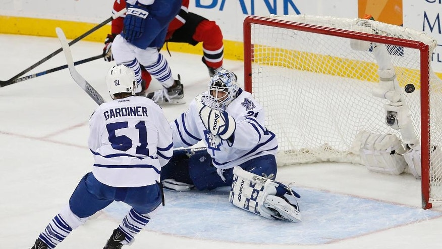 A shot by New Jersey Devils left wing Patrik Elias (not shown) enters the net of Toronto Maple Leafs goalie Garret Sparks (31) during the third period of an NHL hockey game, Saturday, April 9, 2016, in Newark, N.J. (AP Photo/Julio Cortez)