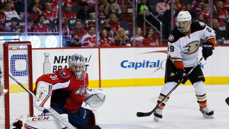 Washington Capitals goalie Philipp Grubauer (31), from Germany, deflects a shot with Anaheim Ducks right wing Chris Stewart (29) nearby, in the second period of an NHL hockey game, Sunday, April 10, 2016, in Washington. (AP Photo/Alex Brandon)