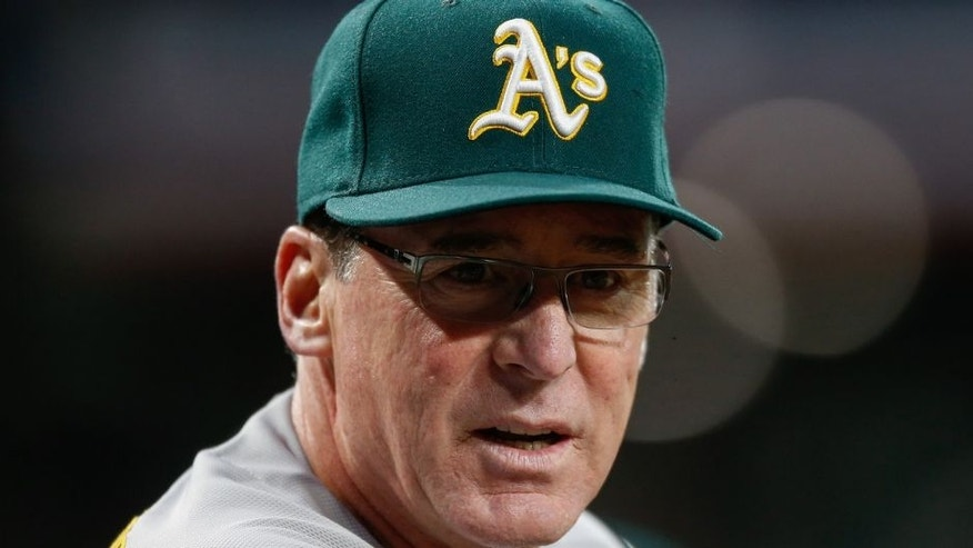 <p>SEATTLE, WA - APRIL 08: Manager Bob Melvin #6 of the Oakland Athletics looks on against the Seattle Mariners in the fifth inning during their home opener at Safeco Field on April 8, 2016 in Seattle, Washington. (Photo by Otto Greule Jr/Getty Images) *** Local Caption *** Bob Melvin</p>