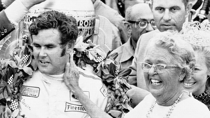 FILE - In this May 30, 1970, file photo, Al Unser Sr. is congratulated by his mother after winning the 54th running of the Indianapolis 500 auto race at Indianapolis Motor Speedway in Indianapolis, Ind. (AP Photo/File)