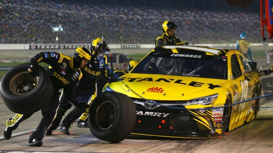 Carl Edwards makes a pit stop during the NASCAR Sprint Cup Series auto race at Texas Motor Speedway in Fort Worth, Texas, Saturday, April 9, 2016. (AP Photo/Ralph Lauer)