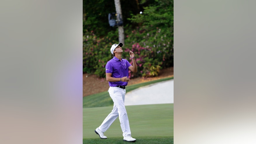Smylie Kaufman throws his ball in the air as he walks to the 14th tee during the final round of the Masters golf tournament Sunday, April 10, 2016, in Augusta, Ga. (AP Photo/Matt Slocum)