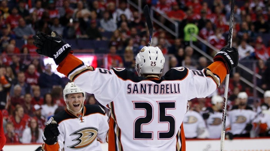 Anaheim Ducks center Mike Santorelli (25) celebrates his goal with right wing Chris Wagner (62) in the second period of an NHL hockey game against the Washington Capitals, Sunday, April 10, 2016, in Washington. (AP Photo/Alex Brandon)