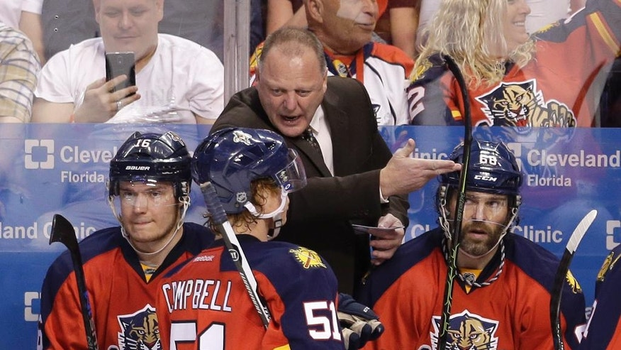 Florida Panthers head coach Gerard Gallant talks to the players during a timeout during the third period of an NHL hockey game against the Carolina Hurricanes, Saturday, April 9, 2016, in Sunrise, Fla. The Panthers won 5-2. (AP Photo/Alan Diaz)