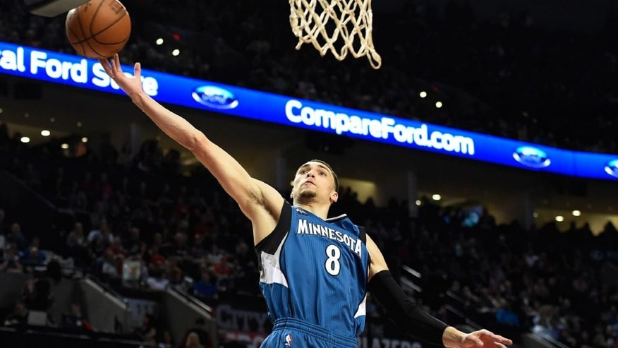 Minnesota Timberwolves guard Zach LaVine loses control of the ball during the first quarter of an NBA basketball game against the Portland Trail Blazers.