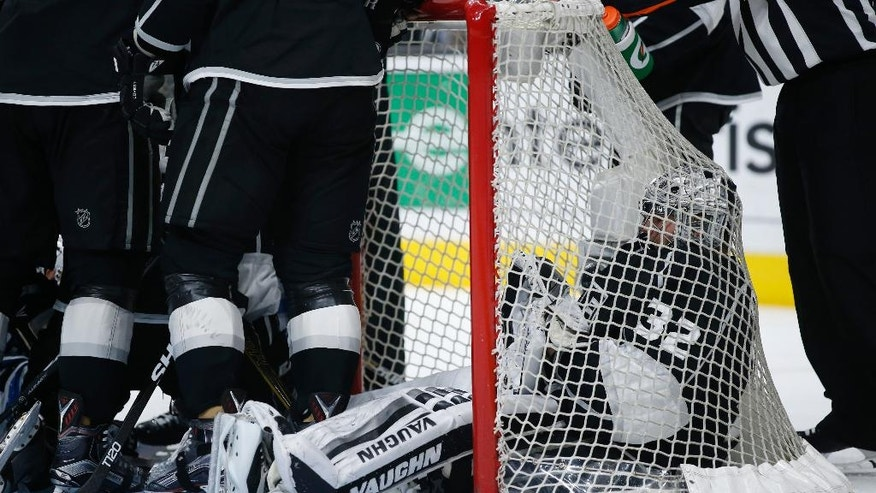 Los Angeles Kings goalie Jonathan Quick sits in the net as he waits for the crease to clear of players following a whistle, after making a save against the Winnipeg Jets during the third period of an NHL hockey game, Saturday, April 9, 2016, in Los Angeles. (AP Photo/Danny Moloshok)