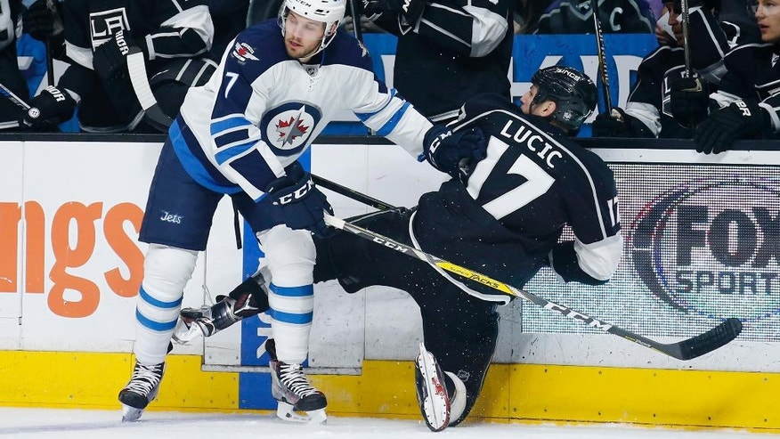Winnipeg Jets defenseman Ben Chiarot, left, checks Los Angeles Kings left wing Milan Lucic, right, during the first period of an NHL hockey game, Saturday, April 9, 2016, in Los Angeles. (AP Photo/Danny Moloshok)