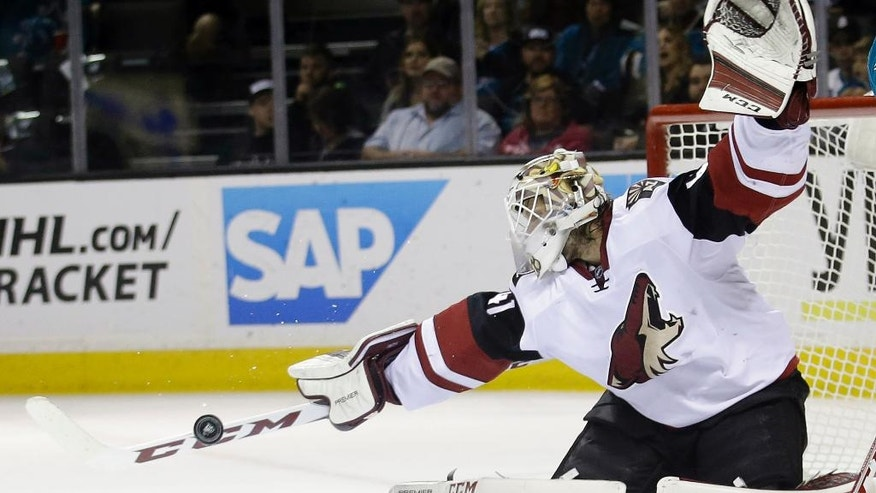 Arizona Coyotes goalie Mike Smith stops a shot against the San Jose Sharks during the first period of an NHL hockey game Saturday, April 9, 2016, in San Jose, Calif. (AP Photo/Marcio Jose Sanchez)
