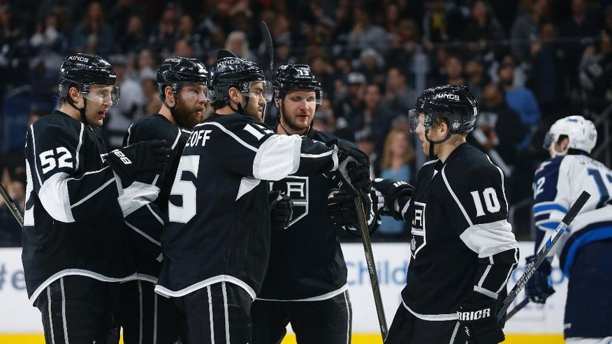 From left to right, Los Angeles Kings' Luke Schenn, Jake Muzzin, Andy Andreoff, Kyle Clifford and Kris Versteeg celebrate Andreoff's goal against the Winnipeg Jets during the second period of an NHL hockey game, Saturday, April 9, 2016, in Los Angeles. (AP Photo/Danny Moloshok)
