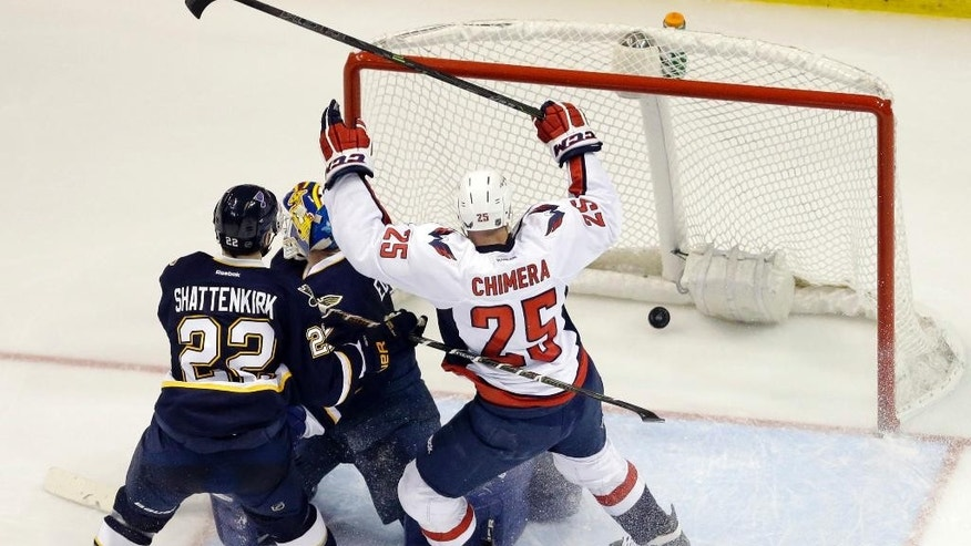 Washington Capitals' Jason Chimera (25) celebrates after scoring past St. Louis Blues goalie Brian Elliott and Kevin Shattenkirk (22) during the second period of an NHL hockey game Saturday, April 9, 2016, in St. Louis. (AP Photo/Jeff Roberson)