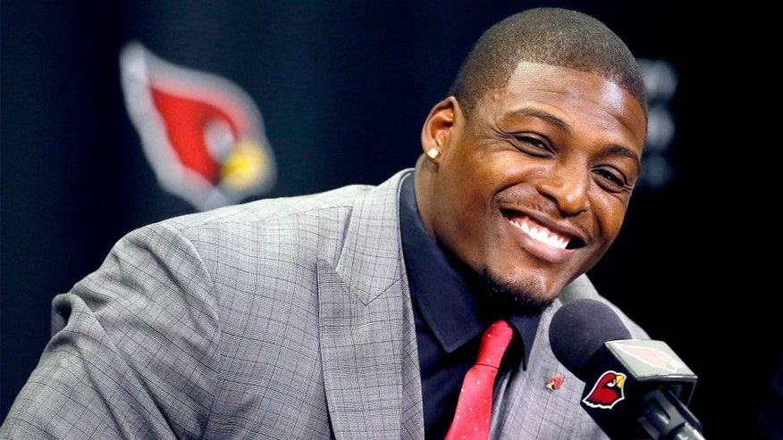 Arizona Cardinals' Adrian Wilson smiles after announcing his retirement, Monday, April 20, 2015, at the Cardinals team facility in Tempe, Ariz. The five-time pro bowler played 12 seasons for the Cardinals. (AP Photo/Matt York)