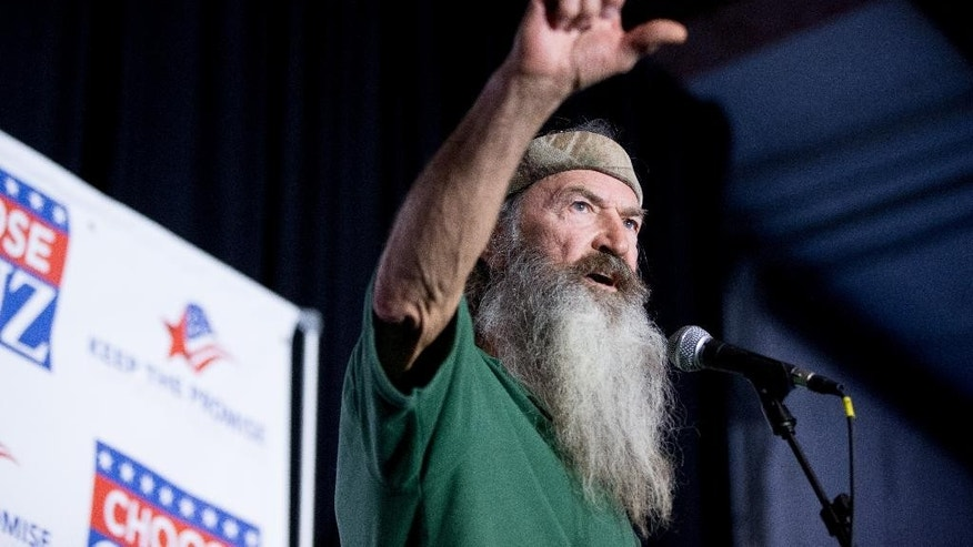 "FILE - In this Feb. 19, 2016 file photo, Phil Robertson of the Duck Dynasty reality television program speaks at a rally for Republican presidential candidate, Sen. Ted Cruz, R-Texas, at Eagle Aviation Hangar in Columbia, S.C. Robertson has again clouded NASCAR's image as a sport trying to remove itself from its divisive stereotypes. Robertson called for a ""Jesus man in the White House"" during what was supposed to be a simple prayer before the race at Texas Motor Speedway on Saturday, April 9. (AP Photo/Andrew Harnik, File)"