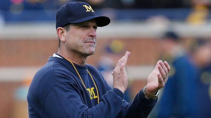 ANN ARBOR, MI - APRIL 01: Head coach Jim Harbaugh of the Michigan Wolverines looks on prior to the Michigan Football Spring Game on April 1, 2016 at Michigan Stadium in Ann Arbor, Michigan. (Photo by Gregory Shamus/Getty Images)