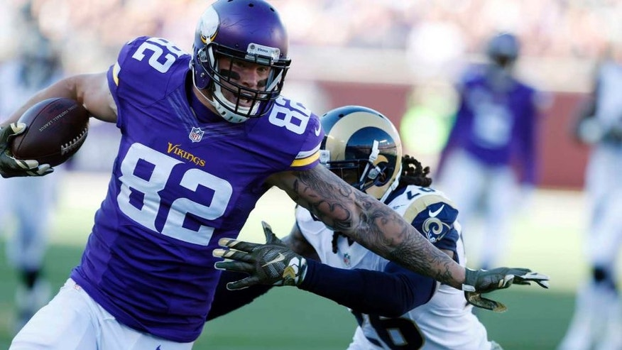 Minnesota Vikings tight end Kyle Rudolph is pulled down by St. Louis Rams outside linebacker Mark Barron during the first half on Sunday, Nov. 8, 2015, in Minneapolis.