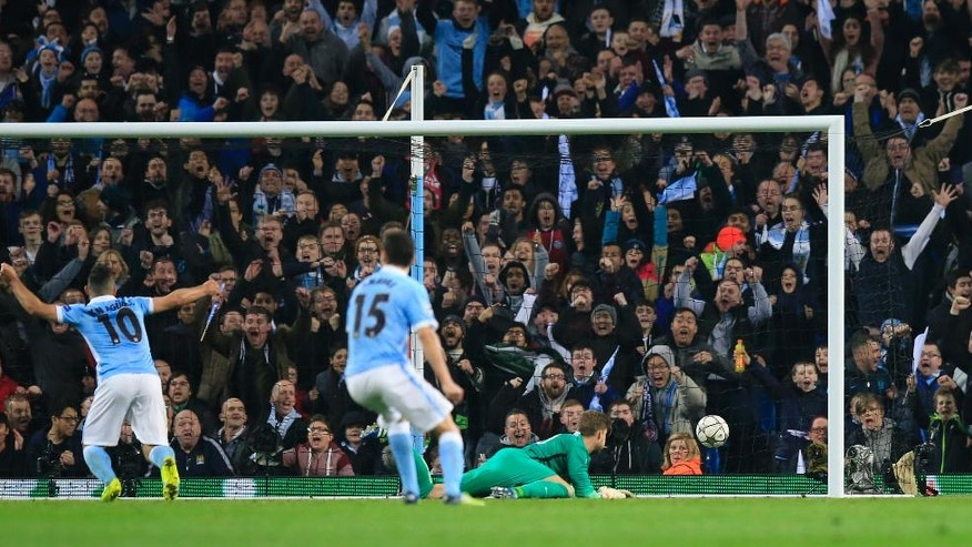 Manchester City's Sergio Aguero and Jesus Navas react and celebrate after Manchester City's Kevin De Bruyne scores the opening goal of the game during the Champions League quarterfinal second leg soccer match between Manchester City and Paris Saint Germain at the City of Manchester stadium in Manchester, England  Tuesday, April 12, 2016. (AP Photo/ Jon Super)
